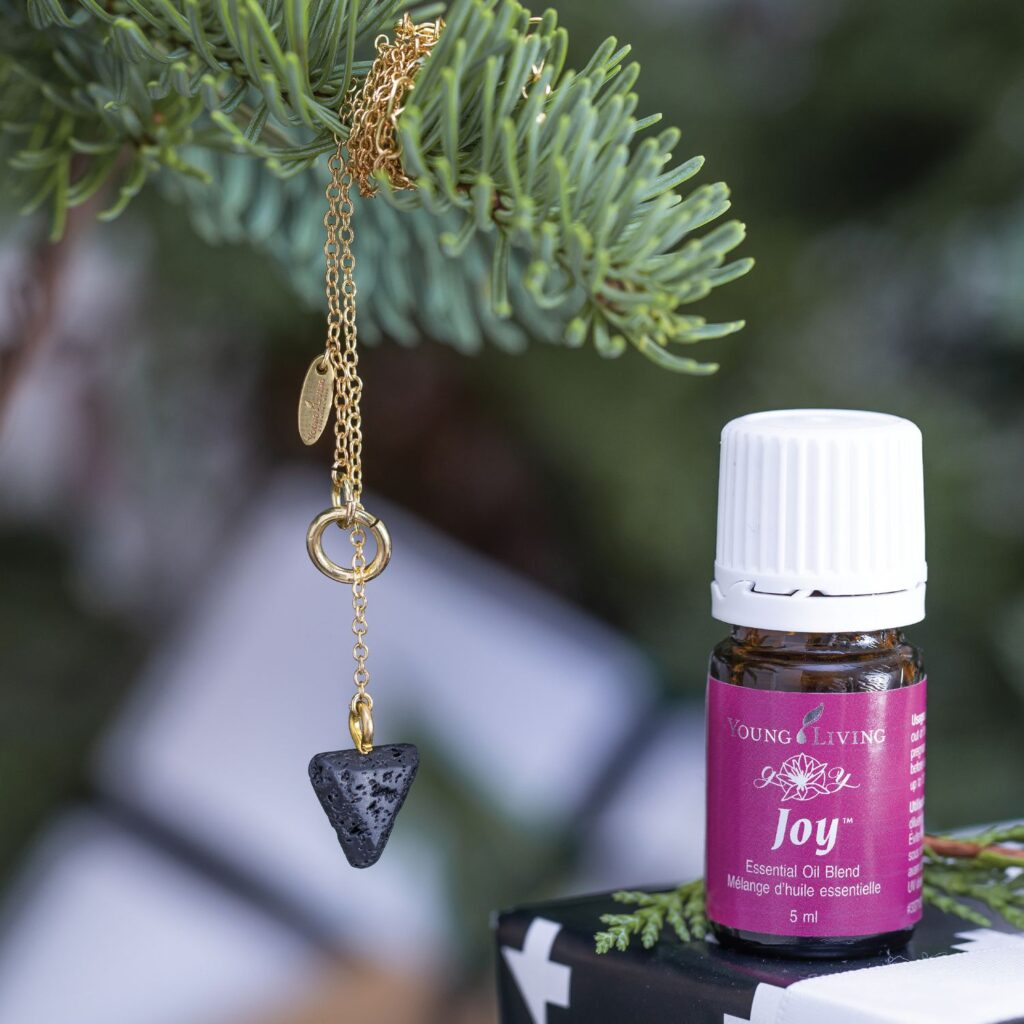 young living lava stone diffuser necklace and joy essential oil
